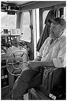 Captain sitting at the wheel. Glacier Bay National Park ( black and white)