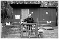 Food and gear cache in the campground, protected from bears by an electric fence. Katmai National Park, Alaska, USA. (black and white)