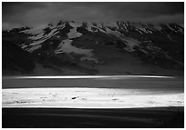 A break in the clouds illuminate the floor of the Valley of Ten Thousand smokes. Katmai National Park ( black and white)
