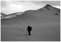 Backpacker leaves the Baked mountain behind, Valley of Ten Thousand smokes. Katmai National Park, Alaska (black and white)