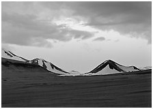 Mt Meigeck emerging above ash plain of Valley of Ten Thousand Smokes at dusk. Katmai National Park, Alaska, USA. (black and white)