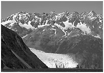 Aialik Glacier, fjord,  and steep mountains. Kenai Fjords National Park, Alaska, USA. (black and white)