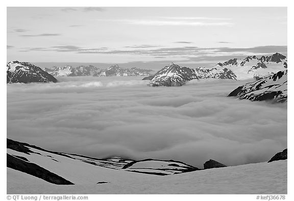Peaks emerging from clouds at sunset. Kenai Fjords National Park (black and white)