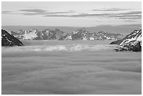 Resurrection Mountains emerging from clouds at sunset. Kenai Fjords National Park, Alaska, USA. (black and white)