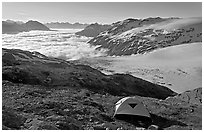 Camping in tent above glacier and sea of clouds. Kenai Fjords National Park, Alaska, USA. (black and white)