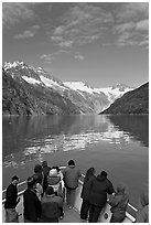 Mountains reflected in fjord, seen by tour boat passengers, Northwestern Fjord. Kenai Fjords National Park, Alaska, USA. (black and white)