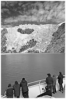 People watch  Northwestern glacier from deck of boat, Northwestern Lagoon. Kenai Fjords National Park, Alaska, USA. (black and white)