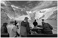 Passengers on the deck of tour boat and Northwestern glacier, Northwestern Lagoon. Kenai Fjords National Park, Alaska, USA. (black and white)