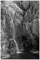 Waterfall streaming into Cataract Cove, Northwestern Fjord. Kenai Fjords National Park, Alaska, USA. (black and white)