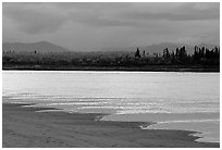 Sand bar shore, bright river and Baird mountains, evening. Kobuk Valley National Park, Alaska, USA. (black and white)