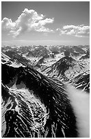 Aerial view of rocky peaks with snow, Chigmit Mountains. Lake Clark National Park, Alaska, USA. (black and white)