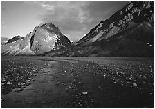 Stream on wide gravel bar and peaks at sunset. Lake Clark National Park ( black and white)