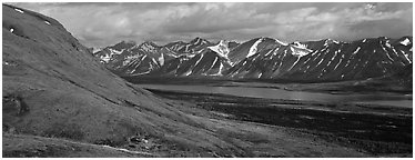 Summer mountain landscape with cloudy skies. Lake Clark National Park (Panoramic black and white)