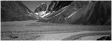 Valley with gravel bar surrounded by steep mountains. Lake Clark National Park (Panoramic black and white)