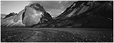 Stream, gravel bar, and mountains at sunset. Lake Clark National Park (Panoramic black and white)