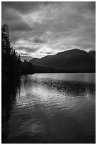 Kontrashibuna Lake with sunrise cloud reflections. Lake Clark National Park ( black and white)