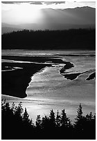 Early morning sun shining on the wide Chitina river. Wrangell-St Elias National Park, Alaska, USA. (black and white)