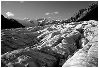 Crevasses on Root glacier, Wrangell mountains in the background, late afternoon. Wrangell-St Elias National Park ( black and white)