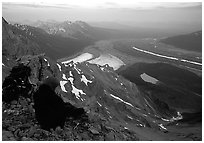 Mountaineer looking down from Mt Donoho. Wrangell-St Elias National Park, Alaska, USA. (black and white)