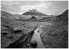 Mt Donoho above moraine, stream, and Root glacier. Wrangell-St Elias National Park, Alaska, USA. (black and white)