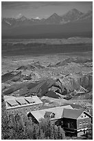 Kennecott mill town buildings and moraines of Root Glacier. Wrangell-St Elias National Park, Alaska, USA. (black and white)