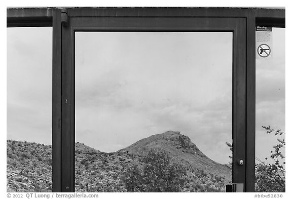 Santiago mountains, Persimmon Gap Visitor Center window reflexion. Big Bend National Park (black and white)