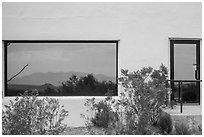 Shrubs, Chisos mountains, Persimmon Gap Visitor Center window reflexion. Big Bend National Park ( black and white)