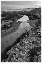 Rio Grande River and Sierra de San Vicente mountains, sunset. Big Bend National Park, Texas, USA. (black and white)