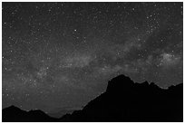 Starry sky and Milky Way above Chisos Mountains. Big Bend National Park ( black and white)