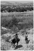 Mexican horsemen from Boquillas Village. Big Bend National Park, Texas, USA. (black and white)