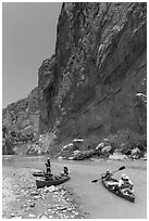 Canoeists bellow steep walls of Boquillas Canyon. Big Bend National Park ( black and white)