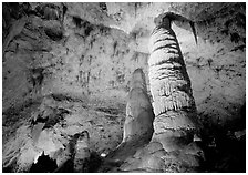 Six-story tall colum and stalagmites in Hall of Giants. Carlsbad Caverns National Park, New Mexico, USA. (black and white)