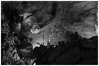 Park visitor looking,  room above Whales Mouth. Carlsbad Caverns National Park ( black and white)