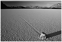 Tracks, moving rock on the Racetrack, late afternoon. Death Valley National Park, California, USA. (black and white)
