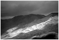 Storm light on foothills. Death Valley National Park ( black and white)