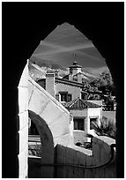 Arch framing Scotty's Castle. Death Valley National Park, California, USA. (black and white)