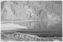 Rare seasonal lake on Death Valley floor and Black range, seen from above, late afternoon. Death Valley National Park ( black and white)