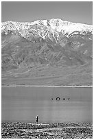 Tourist, ephemeral Loch Ness Monster in Manly Lake, and Telescope Peak. Death Valley National Park, California, USA. (black and white)
