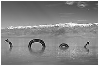 Dragon art installation in Manly Lake and Panamint range. Death Valley National Park, California, USA. (black and white)