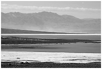 Salt Flats on Valley floor and Owlshead Mountains, early morning. Death Valley National Park ( black and white)