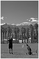 Golfer in Furnace Creek Golf course. Death Valley National Park ( black and white)