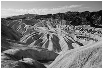 Visitor looking, Zabriskie Point. Death Valley National Park ( black and white)
