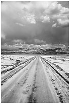 Straight road through Salt Pan. Death Valley National Park ( black and white)