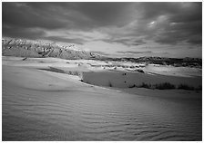 Red light of sunset on white sand dunes and Guadalupe range. Guadalupe Mountains National Park ( black and white)