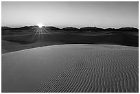 Sun setting over Andres Mountains. White Sands National Park ( black and white)