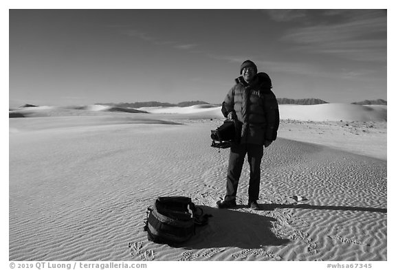 Photographer holding large format camera. White Sands National Park (black and white)