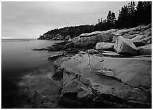 Coastline with granite slabs near Otter Point, sunrise. Acadia National Park ( black and white)