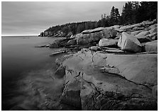 Granite slabs and Otter Point at sunrise. Acadia National Park ( black and white)