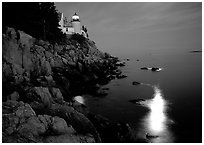 Bass Harbor lighthouse by night with moon reflection in ocean. Acadia National Park ( black and white)