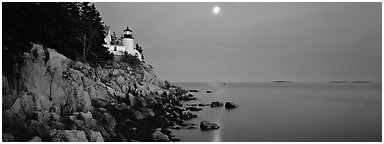 Dusk seascape with lightouse, moon, and reflection. Acadia National Park (Panoramic black and white)